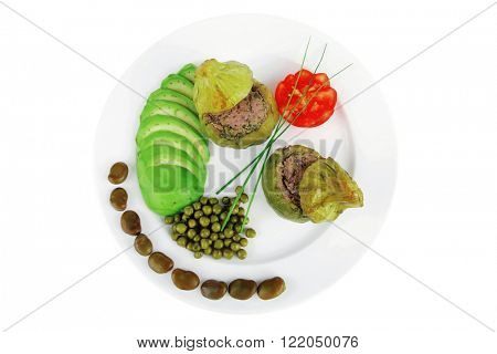 gourmet food: zucchini filled with mince meat on white dish with beans and peas