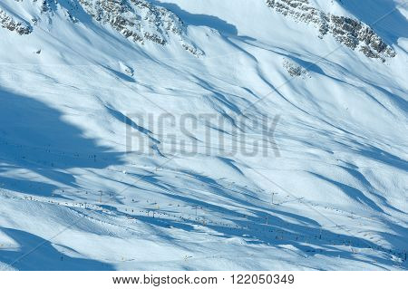 Scenery from the cabin ski lift at the snowy slopes (Tyrol, Austria). All skiers are unrecognizable.
