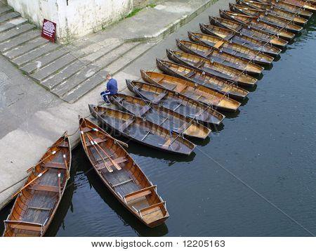 Rows of empty row boats.