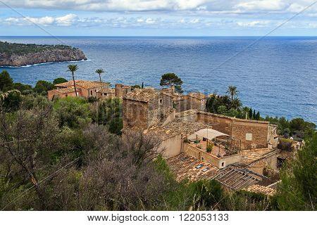 Llucalcari Serra de Tramuntana old village UNESCO world heritage, northwest coast of Mallorca at Balearic Islands, cloudy winter day