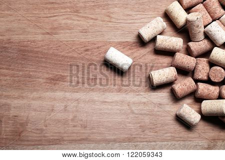 Wine corks on wooden background
