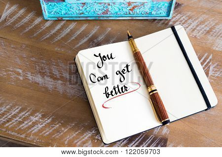 Retro effect and toned image of a fountain pen on a notebook. Handwritten text You Can Get Better as business concept image