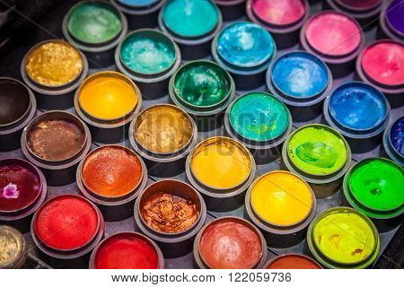 Colorful paint tubes on a table with paints used for face art