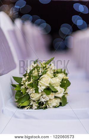 White Bouquet On White Chair