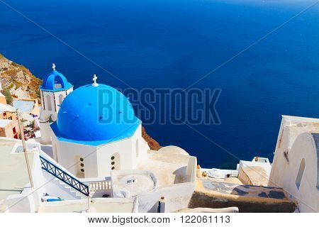 traditional  blue dome of church and blue sea water, Oia, Santorini