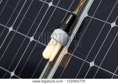 Energy saving light bulb on the solar panel