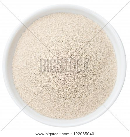 Portion of dried yeast isolated on white background