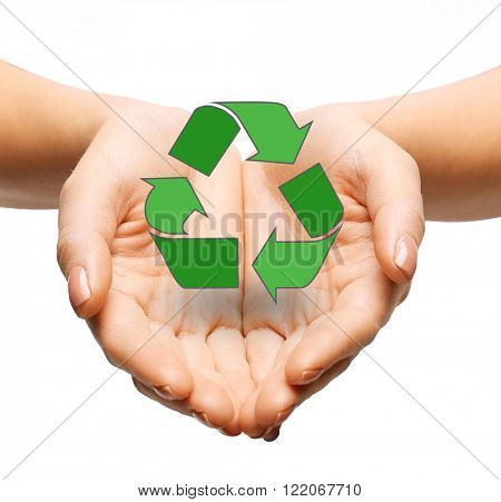 people, ecology, environment and conservation concept - close up of hands holding green recycling sign