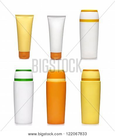 Six genric plastic containers. Beaty goods. Sunscreen bottles on white background