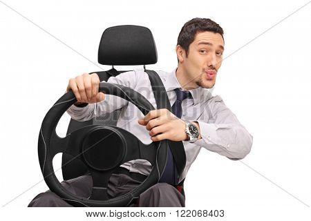 Confident young man driving and whistling with his mouth isolated on white background