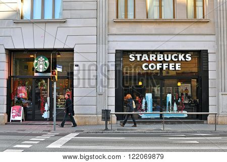 BARCELONA SPAIN - DECEMBER 30: Starbucks coffeeshop on the street of Barcelona on December 30 2014. Starbucks is the largest coffeehouse chain in the world.