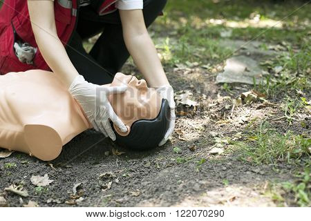 Paramedic demonstrates Cardiopulmonary resuscitation - CPR on dummy. Artificial respiration.