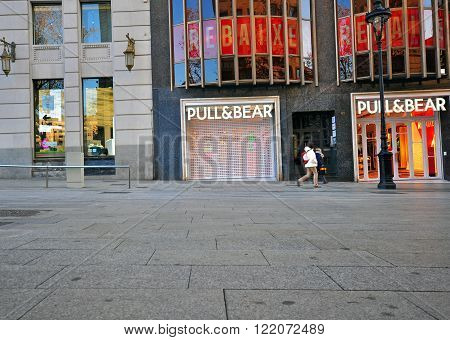 BARCELONA SPAIN - JANUARY 17: Pull and Bear store in the street of Barcelona city on January 17 2015. Barcelona is the capital of Catalonia and second largest city of Spain.