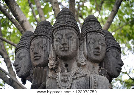 Wooden carved statue in gardens at Ancient Siam near Bangkok, Thailand.