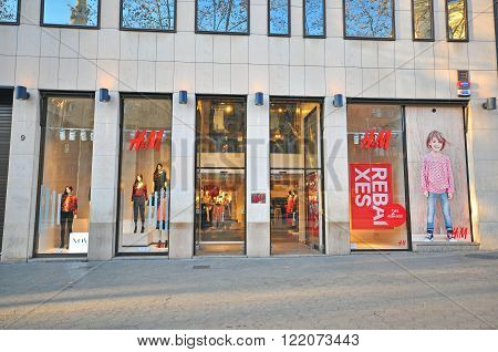 BARCELONA SPAIN - JANUARY 17: H&M store in Paseo de Gracia street in Barcelona on January 17 2015. Barcelona is the capital of Catalonia and second largest city of Spain.