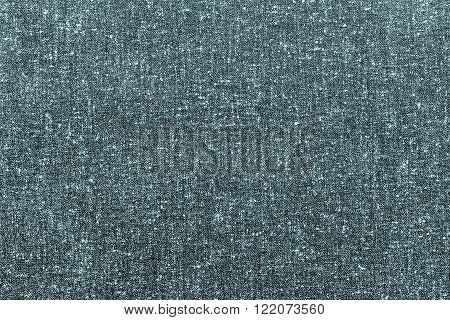 abstract speckled texture of dense fabric of turquoise color for textile backgrounds or for wallpaper