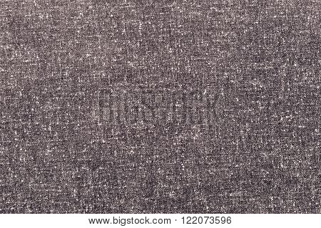 abstract speckled texture of dense fabric of brown color for textile backgrounds or for wallpaper