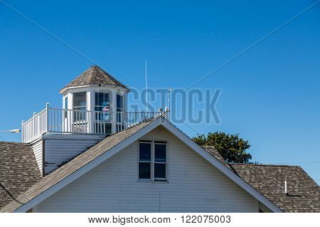 Old coastal roof with a cupola and widow's walk
