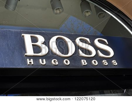 BARCELONA SPAIN - FEBRUARY 1: Logo of Hugo Boss flagship store in the street of Barcelona on February 1 2014. Hugo Boss is a world famous sport brand.