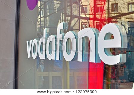 BARCELONA SPAIN - FEBRUARY 5: Logo of Vodafone company in the shop on February 5 2015. Vodafone is a British multinational telecommunications company.