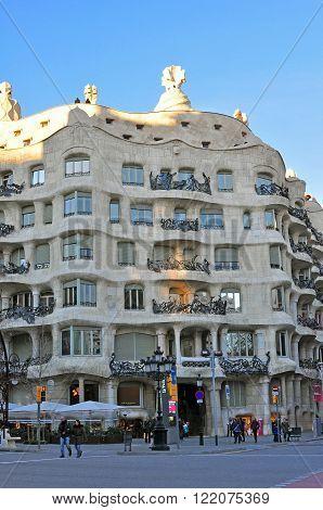 BARCELONA SPAIN - FEBRUARY 5: Facade of the Casa Mila by Gaudi in Barcelona on February 5 2014. Barcelona is the capital city of Catalonia Spain.
