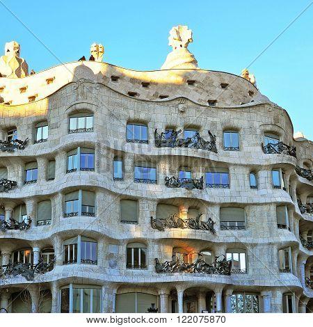 BARCELONA SPAIN - FEBRUARY 5: Facade of the Casa Mila house in Barcelona February 5 2014. Barcelona is the capital city of Catalonia Spain.