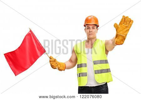 Construction worker waving a red flag and making a stop hand gesture isolated on white background
