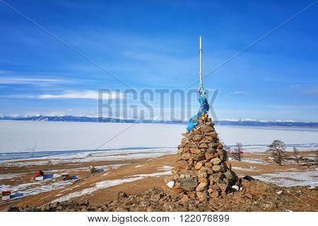 Single Buddhist cairn on hill of Lake Hovsgol . Mongolia