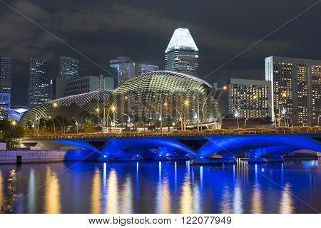 bright scenic illumination on the embankment of Singapore river