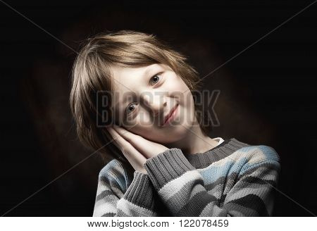 Portrait of a Boy Leaning his Head on his Hands