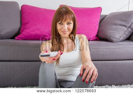 Woman With Television Remote Control