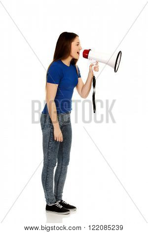 Screaming young woman with megaphone.