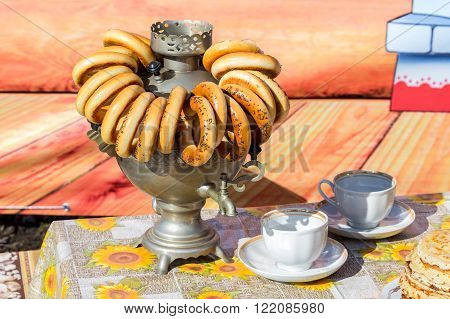 Traditional Russian tea from Samovar with bagels and pancakes