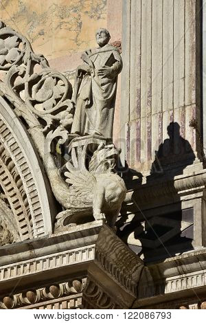 Detail of Scuola Grande di San Marco renaissance portal in Venice with two statues of saint and griffin (now the entrance of Venice main hospital)