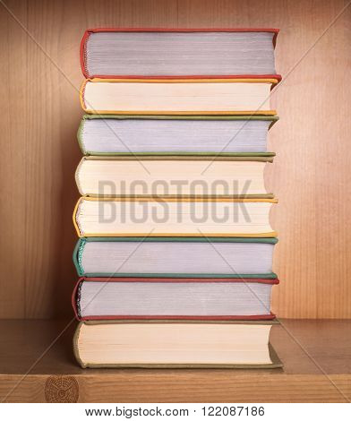stack of book isolated on a wooden background