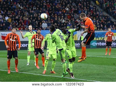 LVIV, UKRAINE - March 10, 2016: Olexandr Kucher of FC Shakhtar Donetsk (R, #5) scores during the UEFA Europa League Round of 16 game against RSC Anderlecht at Lviv Arena. Shakhtar won 3-1