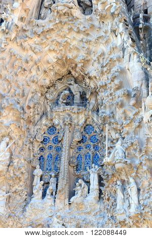Barcelona, Spain - November 10, 2015: Details of Nativity facade at Sagrada Familia. The church is designed by architect Antoni Gaudi and is still under construction. 