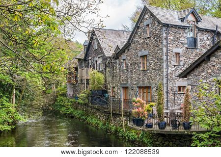 Lake District United Kingdom - May 09 2015: Grasmere village cottages with flower pots the Lake District Cumbria England