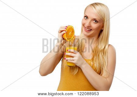 Woman squeeze orange juice in a glas