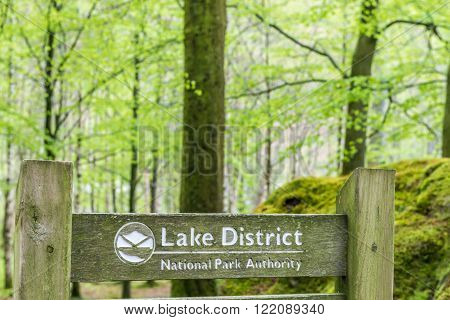 Lake District United Kingdom - May 09 2015: Lake District Penny Wood Rock sign