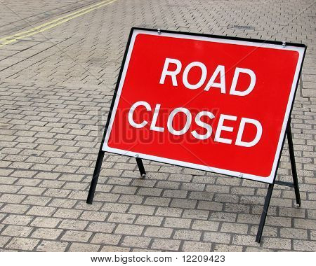 Road closed sign in cobbled street