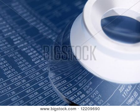 Magnifying loop placed over stock figures