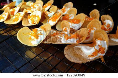Khanom Beaung Thai or a kind of filled pancake Thai food or Thai Style Crisp Tart on tray Thailand - (Selective focus)