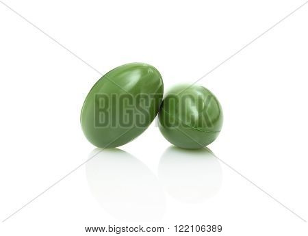 green herbal supplement capsule isolated on white background with clipping path