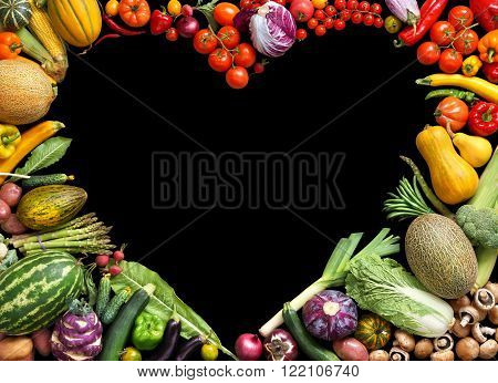 Deluxe Heart symbol. Food photography of heart made from different fruits and vegetables isolated black background. Copy space. High resolution product