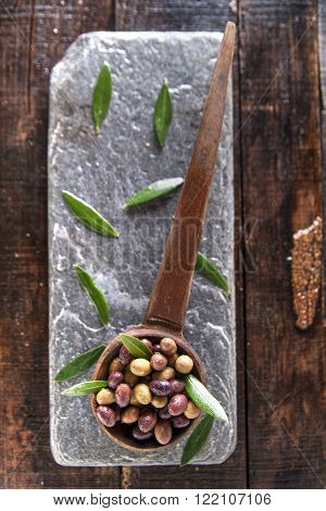 Aperitif with mixed olives in brine of Tuscany Italy
