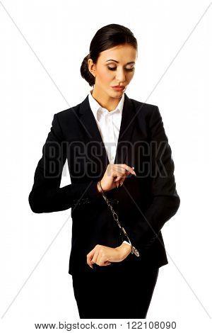 Businesswoman with handcuffs