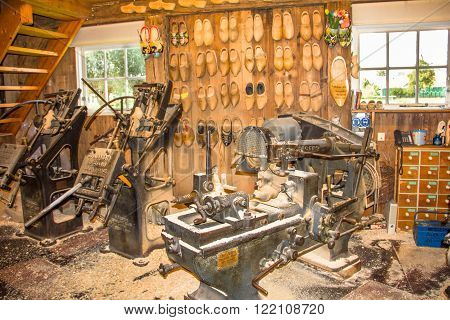 ZAANDAM, THE NETHERLANDS - SEPTEMBER 5, 2012: Machines to produce Dutch wooden clogs in Zaandam. The clogs are used in agriculture, factories and mines and are a typical souvenir from the country.