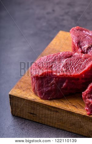 Steak. Raw beef steak. Fresh raw Sirloin beef steak sliced or whole ready for BBQ or grill. 