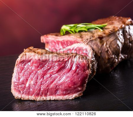 Steak. Grill beef steak. Portions thick beef juicy sirloin steaks on concrete granite background
